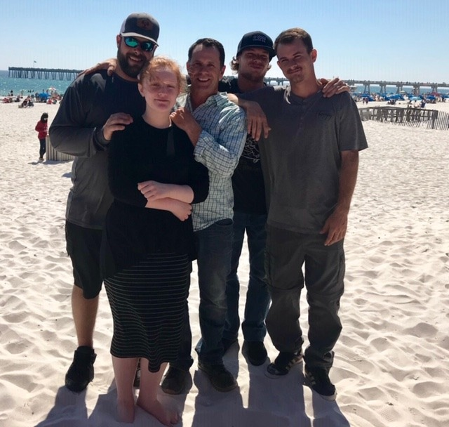 Photo of 4 men and a girl